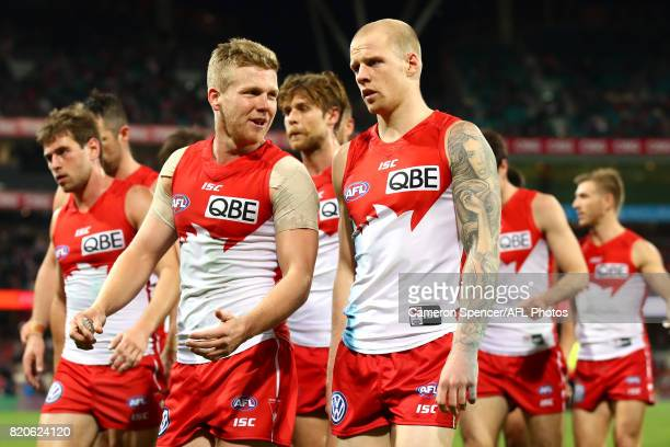Dan Hannebery of the Swans talks to team mate Zak Jones during the round 18 AFL match between the Sydney Swans and the St Kilda Saints at Sydney...