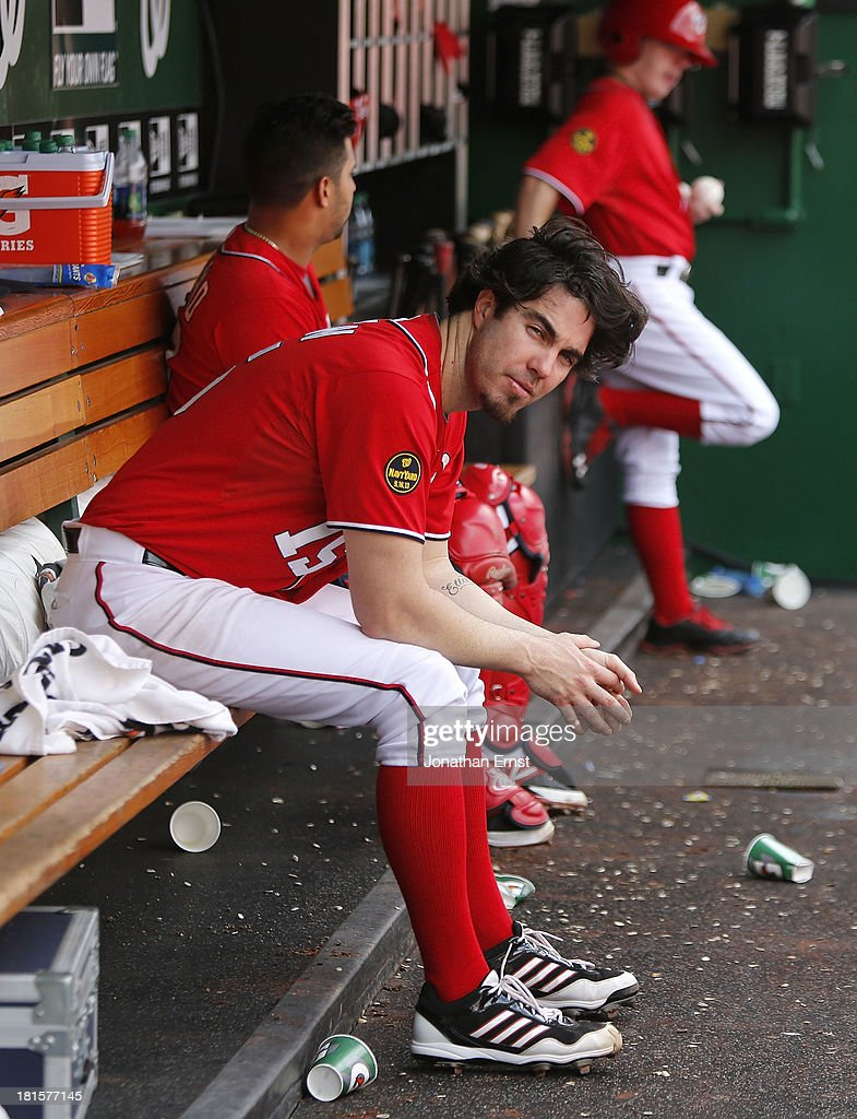 Dan Haren #15 of the Washington Nationals sits on the bench after being pulled in the seventh inning of a 4-2 loss to the Miami Marlins in the first game of their day-night doubleheader at Nationals Park on September 22, 2013 in Washington, DC.