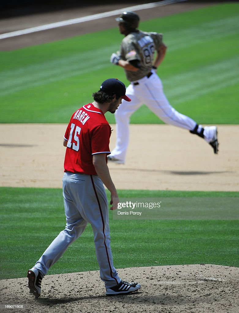 Dan Haren #15 of the Washington Nationals walks back to the mound as Kyle Blanks #88 of the San Diego Padres rounds the bases after he hit a two run homer during the fifth inning of a baseball game against the San Diego Padres at Petco Park on May 19, 2013 in San Diego, California.