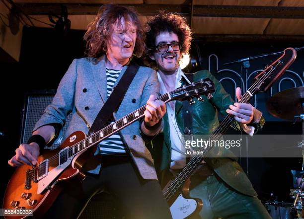 Dan Hawkins and Frankie Poullain of The Darkness perform on stage at HMV Oxford Street on October 6 2017 in London England