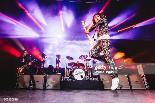 Dan Hawkins and Justin Hawkins of the British rock band The Darkness perform on stage at La Riviera on January 30 2020 in Madrid Spain