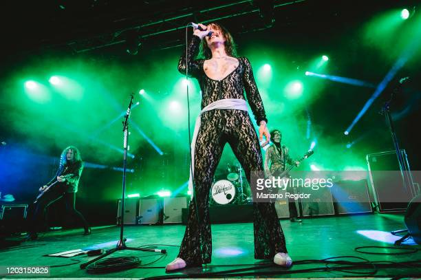 Dan Hawkins Justin Hawkins and Frankie Poullain of the British rock band The Darkness perform on stage at La Riviera on January 30 2020 in Madrid...