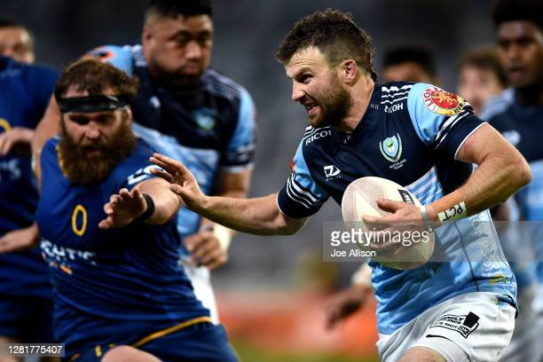 Dan Hawkins of Northland fends off the defence during the round 7 Mitre 10 Cup match between Otago and Northland at Forsyth Barr Stadium on October...