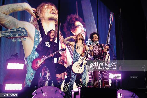 Dan Hawkins Rufus Taylor Justin Hawkins and Frankie Poullain of British rock group The Darkness performing live on stage at Chantry Park in Ipswich...