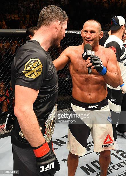 Dan Henderson chats with Michael Bisping of England after their UFC middleweight championship bout during the UFC 204 Fight Night at the Manchester...
