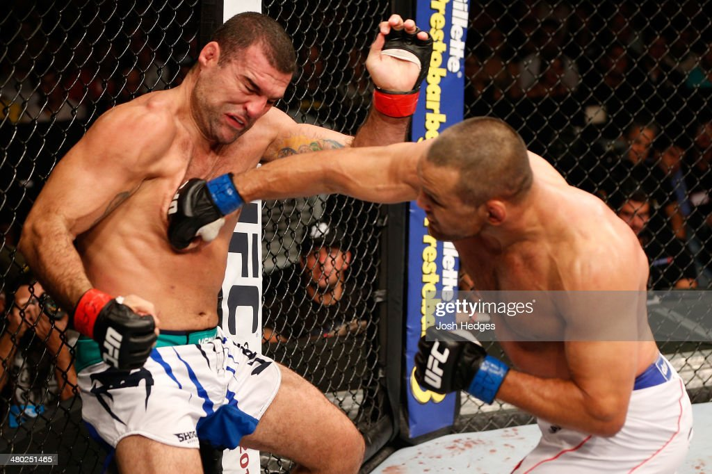 Dan Henderson punches Mauricio 'Shogun' Rua in their light heavyweight bout during the UFC Fight Night event at Ginasio Nelio Dias on March 23, 2014 in Natal, Brazil.
