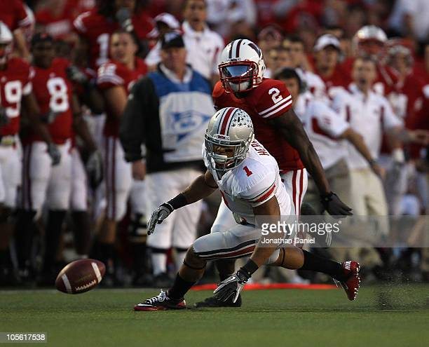 Dan Herron of the Ohio State Buckeyes chases down a ball he fumbled on a pitchout as Jay Valai of the Wisconsin Badgers closes in at Camp Randall...