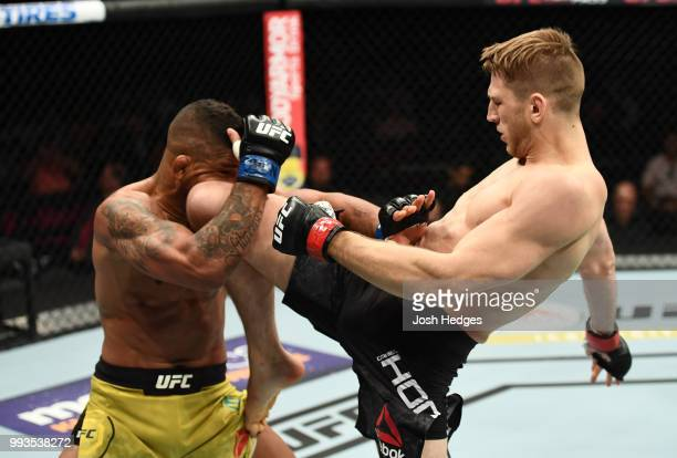 Dan Hooker knees Gilbert Burns in their lightweight fight during the UFC 226 event inside T-Mobile Arena on July 7, 2018 in Las Vegas, Nevada.