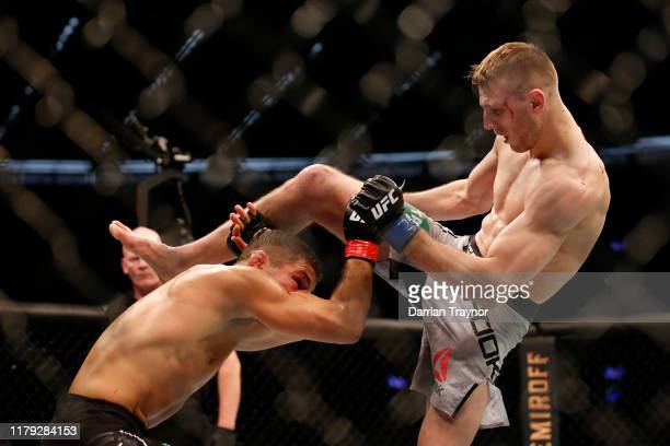 Dan Hooker of New Zealand and Al Iaquinta of the United States fight in their Lightweight bout during UFC 243 at Marvel Stadium on October 06, 2019...