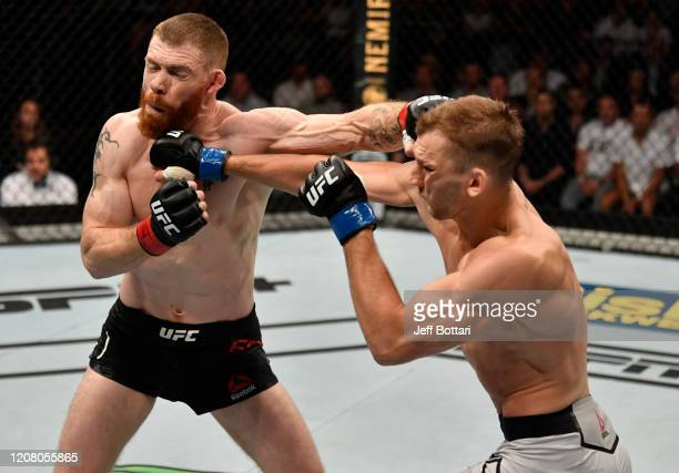 Dan Hooker of New Zealand and Paul Felder trade punches in their lightweight during the UFC Fight Night event at Spark Arena on February 23, 2020 in...