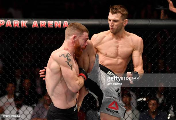 Dan Hooker of New Zealand knees Paul Felder in their lightweight during the UFC Fight Night event at Spark Arena on February 23, 2020 in Auckland,...