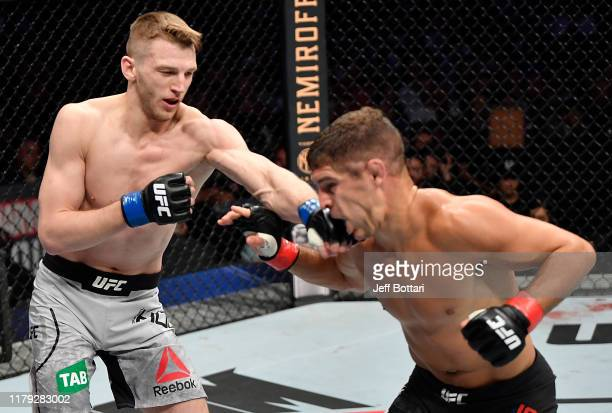 Dan Hooker of New Zealand punches Al Iaquinta in their lightweight fight during the UFC 243 event at Marvel Stadium on October 06, 2019 in Melbourne,...