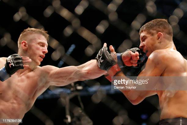 Dan Hooker of New Zealand punches Al Iaquinta of the United States in their Lightweight bout during UFC 243 at Marvel Stadium on October 06, 2019 in...