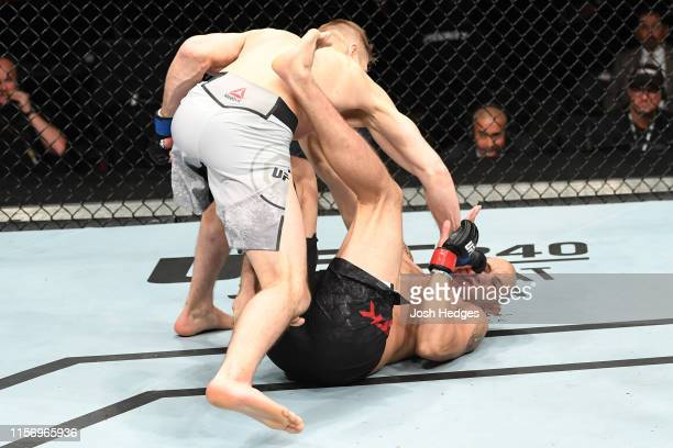 Dan Hooker of New Zealand punches James Vick in their lightweight bout during the UFC Fight Night event at AT&T Center on July 20, 2019 in San...
