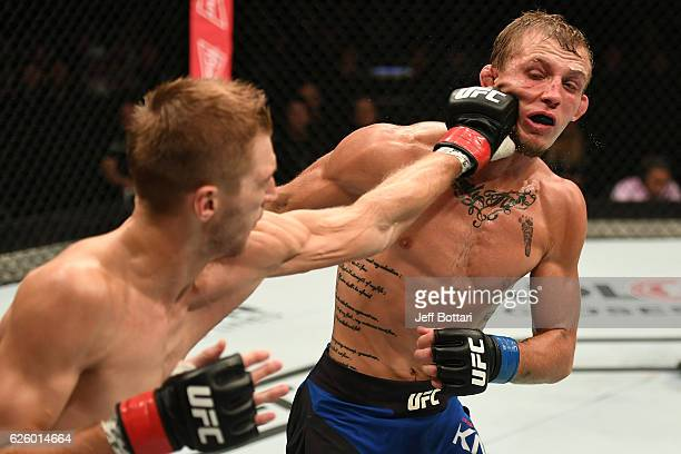 Dan Hooker of New Zealand punches Jason Knight in their featherweight bout during the UFC Fight Night event at Rod Laver Arena on November 27 2016 in...