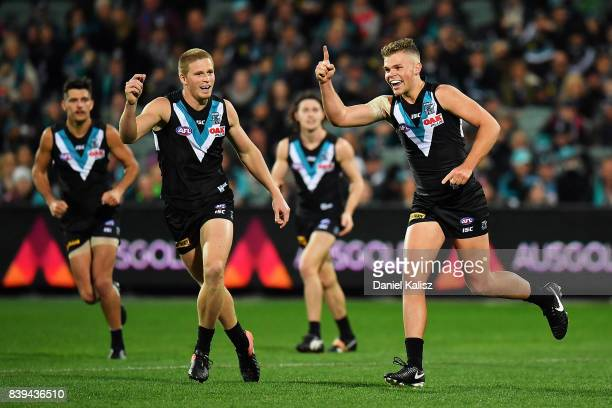 Dan Houston of the Power celebrates after kicking a goal during the round 23 AFL match between the Port Adelaide Power and the Gold Coast Suns at...