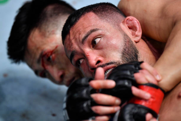 Dan Ige battles 'The Korean Zombie' Chan Sung Jung of South Korea in a featherweight bout during the UFC Fight Night event at UFC APEX on June 19,...