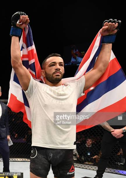Dan Ige celebrates after his submission victory over Danny Henry of Scotland in their featherweight bout during the UFC Fight Night event at The O2...