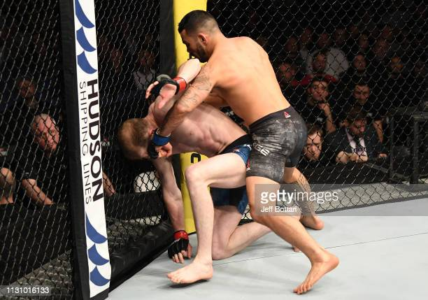 Dan Ige punches Danny Henry of Scotland in their featherweight bout during the UFC Fight Night event at The O2 Arena on March 16 2019 in London...