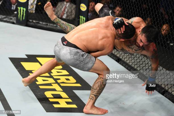 Dan Ige takes down Kevin Aguilar in their featherweight bout during the UFC Fight Night event at Bon Secours Wellness Arena on June 22 2019 in...