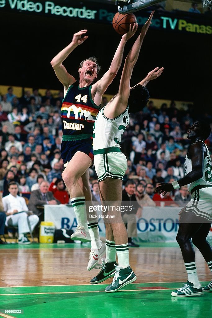 Dan Issel #44 of the Denver Nuggets shoots a layup against Kevin McHale #32 of the Boston Celtics during a game played in 1983 at the Boston Garden in Boston, Massachusetts.