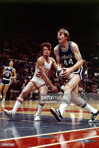 Dan Issel of the Kentucky Colonels drives to the basket against John Melchioni of the New York Nets during an ABA game cieca 1970 at the Nassau...