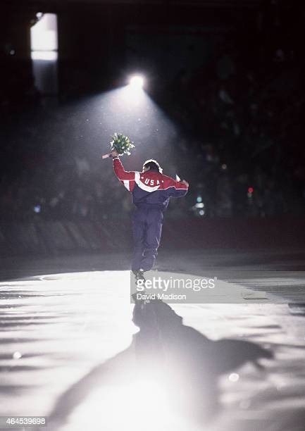 Dan Jansen of the USA skates a victory lap following the Men's 1000 meter event of the Long Track Speed Skating competition of the 1994 Winter...
