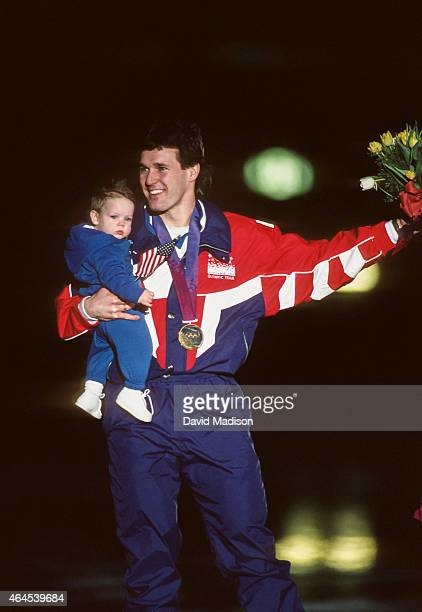 Dan Jansen of the USA skates a victory lap holding his daughter Jane following the Men's 1000 meter event of the Long Track Speed Skating competition...