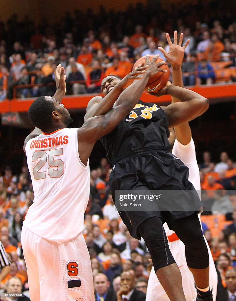 Dan Jennings #35 of the Long Beach State 49ers puts the ball up to the basket against Rakeem Christmas #25 of the Syracuse Orange during the game at the Carrier Dome on December 6, 2012 in Syracuse, New York.
