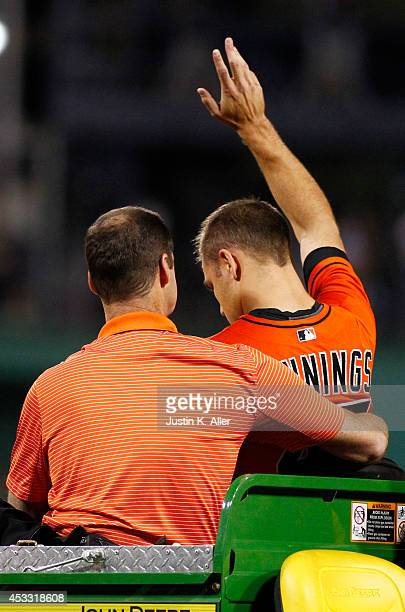 Dan Jennings of the Miami Marlins waves to the crowd after taking a line drive to the head in the seventh inning during the game against the...