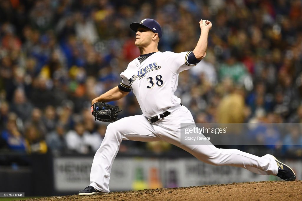 Dan Jennings #38 of the Milwaukee Brewers throws a pitch during the sixth inning of a game against the Cincinnati Reds at Miller Park on April 17, 2018 in Milwaukee, Wisconsin.