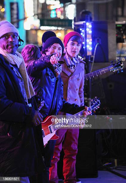 Dan Kanter and Justin Bieber perform during Dick Clark's New Year's Rockin' Eve with Ryan Seacrest 2012 at Times Square on December 31 2011 in New...