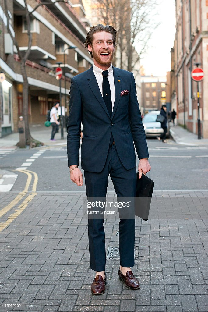 Dan Kennedy fashion journalist for Idol Magazine wearing shoes form a charity shop, Reiss tie and suit and TM Lewin shirt on day 3 of London Mens Fashion Week Autumn/Winter 2013, on January 09, 2013 in London, England.
