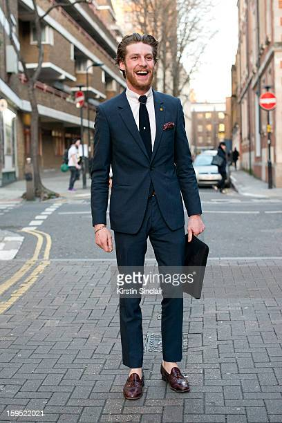 Dan Kennedy fashion journalist for Idol Magazine wearing shoes form a charity shop, Reiss tie and suit and TM Lewin shirt on day 3 of London Mens...