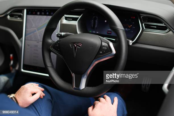 Dan Kiely CEO amp Co Founder of Voxpro takes his hands off the wheel of his Tesla Model S P100D at a launch event for the MobilityX selfdriving...