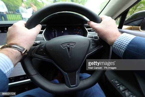 Dan Kiely CEO of Voxpro holds the wheel of his Tesla Model S car at a launch event for the MobilityX selfdriving conference a gathering of global...