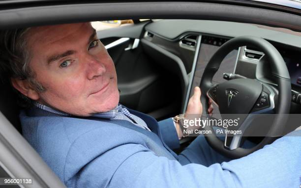Dan Kiely CEO of Voxpro sits in his Tesla Model S car at a launch event for the MobilityX selfdriving conference a gathering of global autonomous...