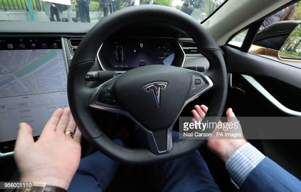 Dan Kiely CEO of Voxpro takes his hands off the wheel of his Tesla Model S car at a launch event for the MobilityX selfdriving conference a gathering...