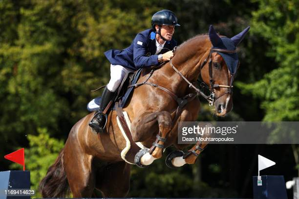 Dan Kremer of Israel riding Chaplin 92 competes during Day 3 of the Longines FEI Jumping European Championship speed competition against the clock...