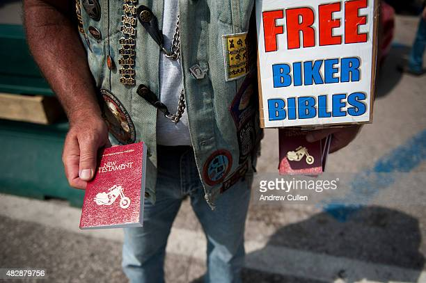 Dan Lawrence hands out free copies of the New Testament downtown on the first day of the annual Sturgis Motorcycle Rally August 3 2015 in Sturgis...