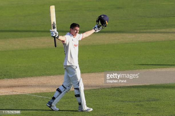 Dan Lawrence of Essex celebrates his century during the Specsavers County Championship Division One match between Essex and Surrey at Cloudfm County...