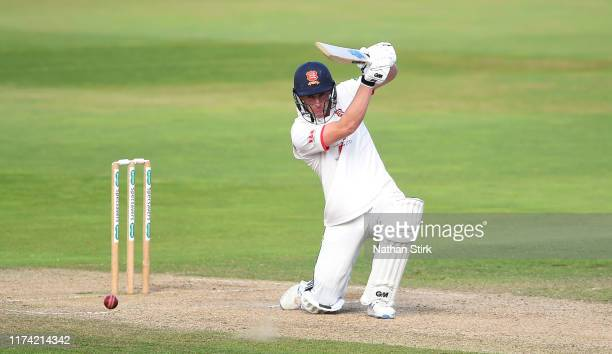 Dan Lawrence of Essex drives the ball while batting during the County Championship Division One match between Warwickshire and Essex at Edgbaston on...