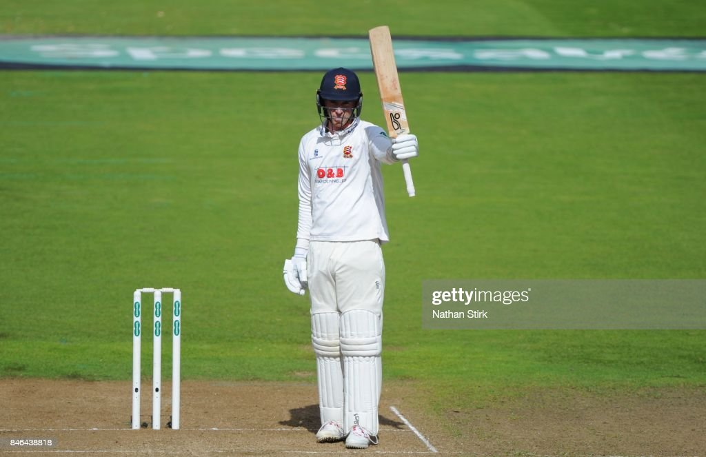 Dan Lawrence of Essex raises his bat after scoring a fifty during the County Championship Division One match between Warwickshire and Essex at Edgbaston on September 13, 2017 in Birmingham, England.