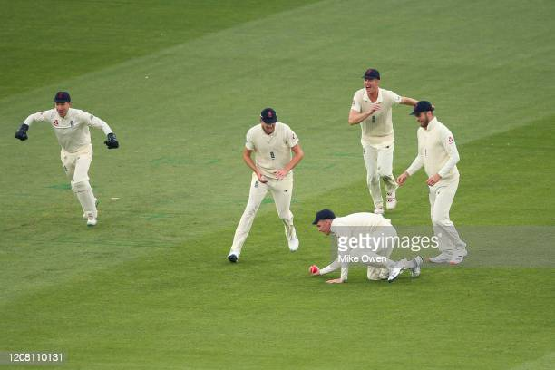 Dan Lawrence of the England Lions catches out Marcus Harris of Australia A during the Four Day match between Australia A and the England Lions at...
