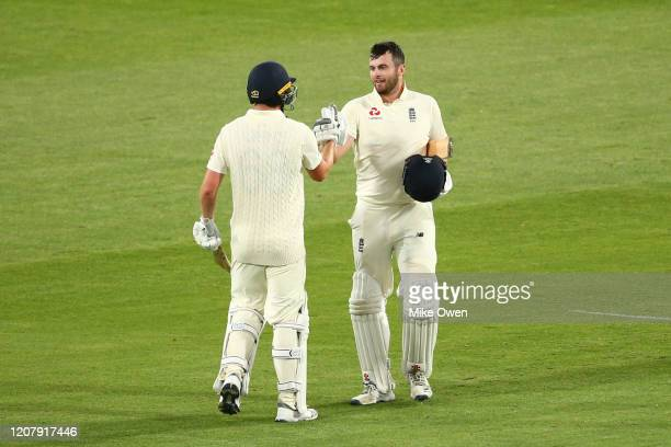Dan Lawrence of the England Lions celebrates with teammate after Dominic Sibley of the England Lions scores a century during the Four Day match...