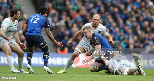 Dan Leavy of Leinster is held during the European Rugby Champions Cup quarter final match between Leinster Rugby and Saracens at the Aviva Stadium on...