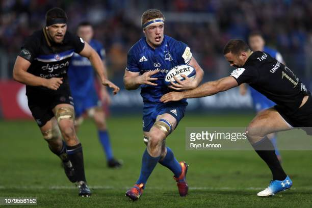 Dan Leavy of Leinster is tackled by Jamie Roberts of Bath during the Champions Cup match between Bath Rugby and Leinster Rugby at Recreation Ground...