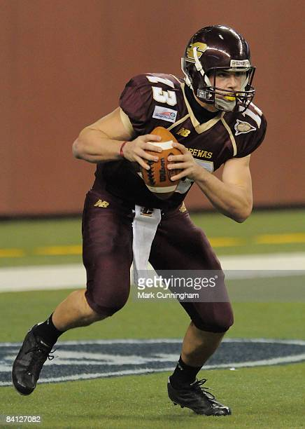 Dan LeFevour of the Central Michigan Chippewas looks to throw a pass against the Florida Atlantic University Owls during the 2008 Motor City Bowl at...