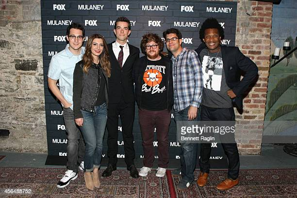 Dan Levy Nasim Pedrad John Mulaney Zack Pearlman Dan Mintz and Seaton Smith pose at the MULANEY NYC Comedy Showcase on October 1 2014 in New York City