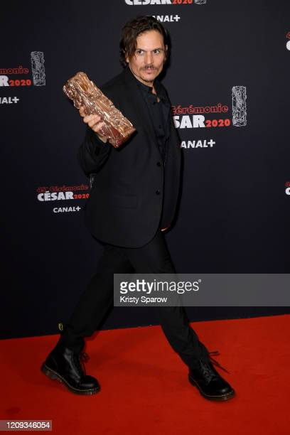 Dan Levy poses with the Best Original Score award for the movie 'J'ai perdu mon corps' during the Cesar Film Awards 2020 Ceremony At Salle Pleyel In...